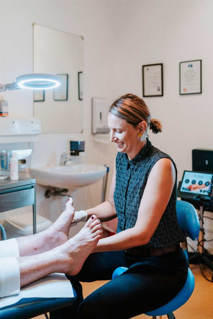 Podiatry Illawarra anna smiling checking foot
