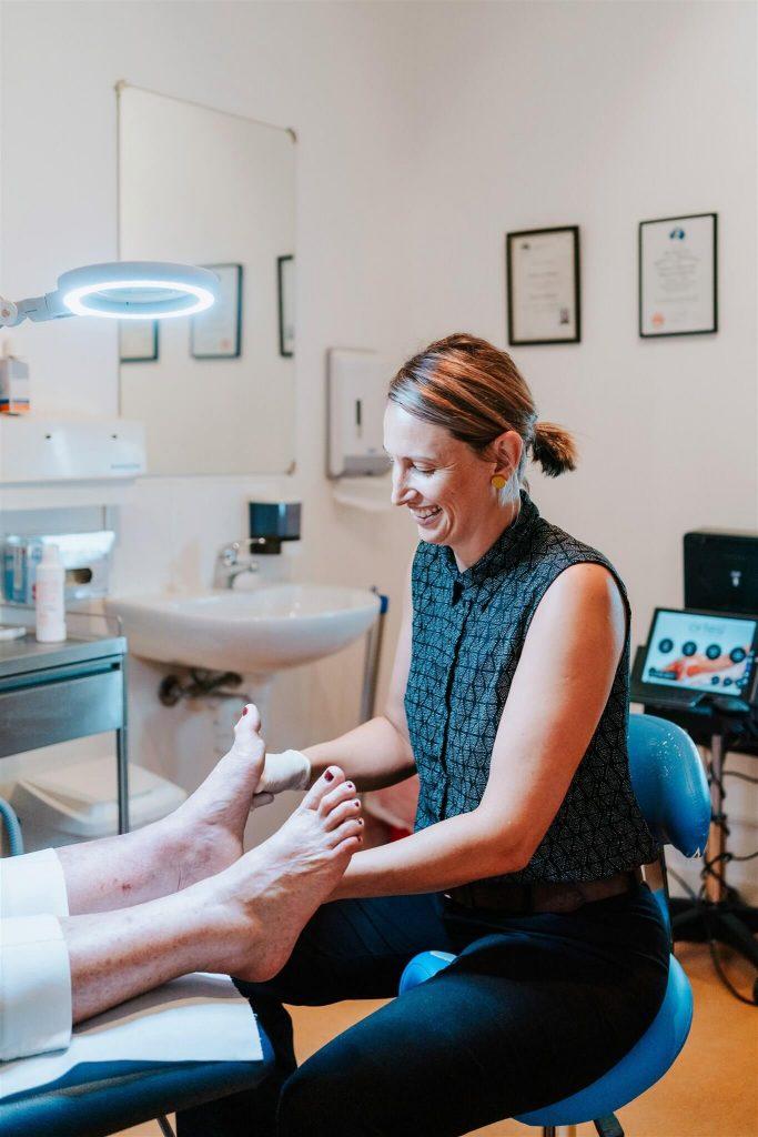 Podiatry Illawarra anna smiling checking foot